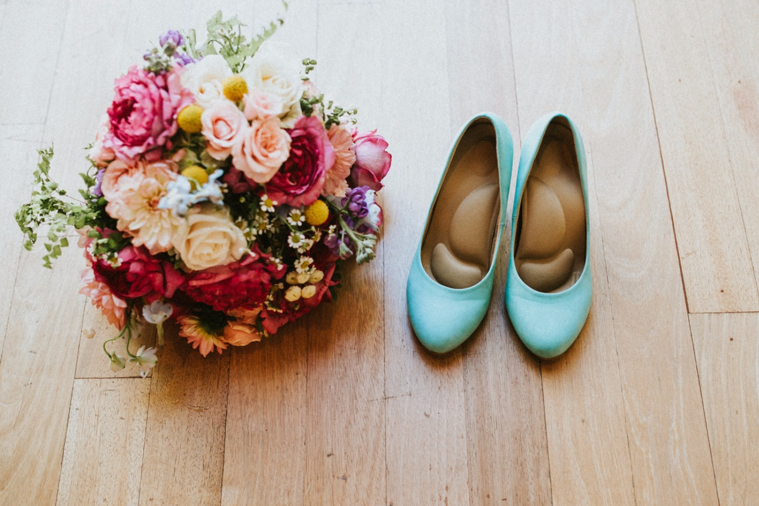 Teal wedding shoes and bouquet