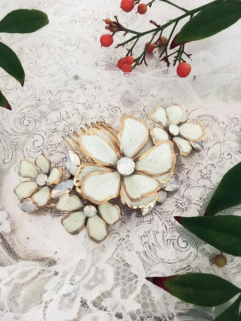 Layered hand-painted flowers and sparkling white opal crystals redefine the floral bridal comb. Bohemian glamour as defined by Debra