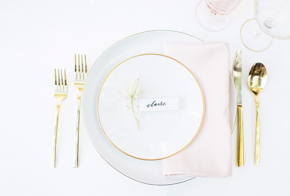 Gold rimmed plates and flatware