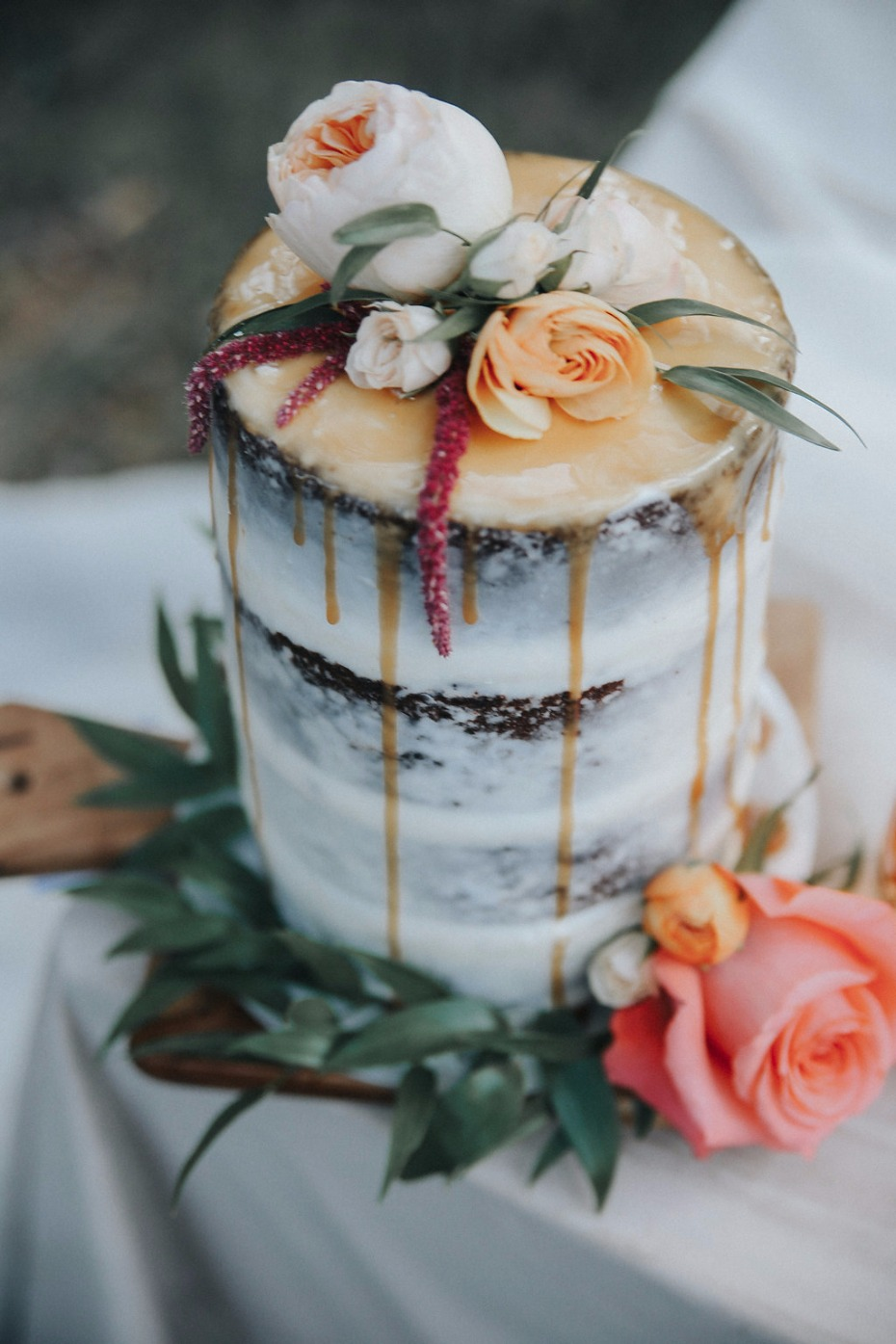 nearly naked wedding cake with caramel drizzle