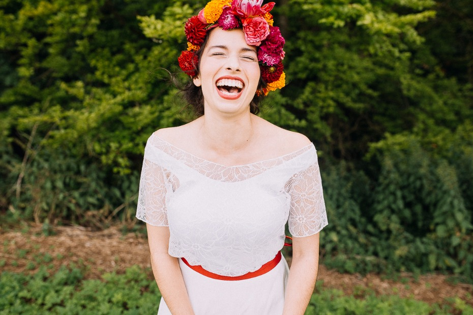 laughing happy bride with floral halo