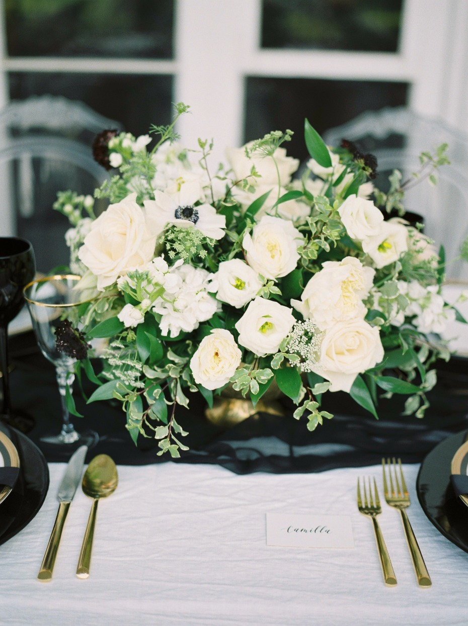 White and green centerpiece with gold flatware