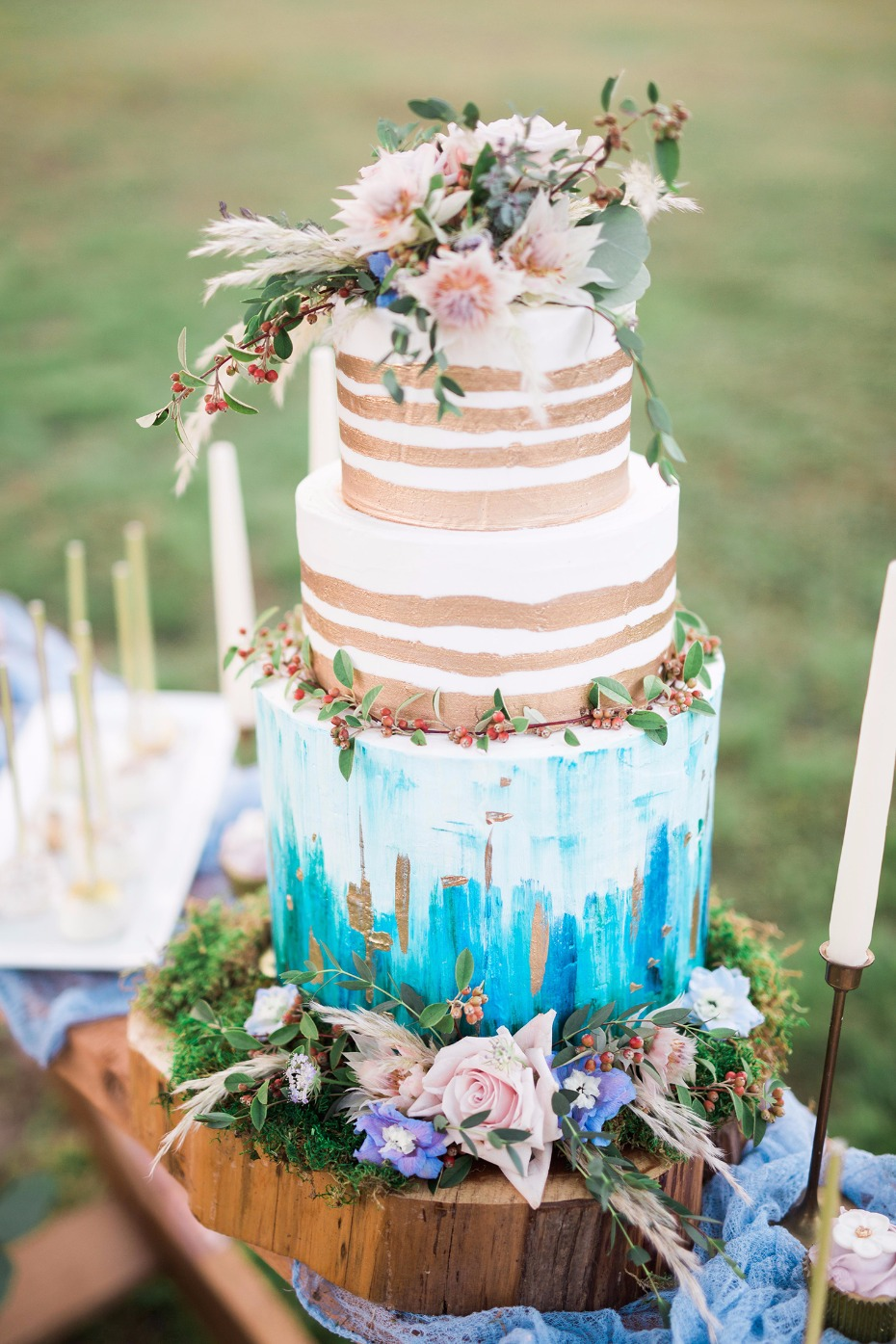 Gold and blue painted wedding cake