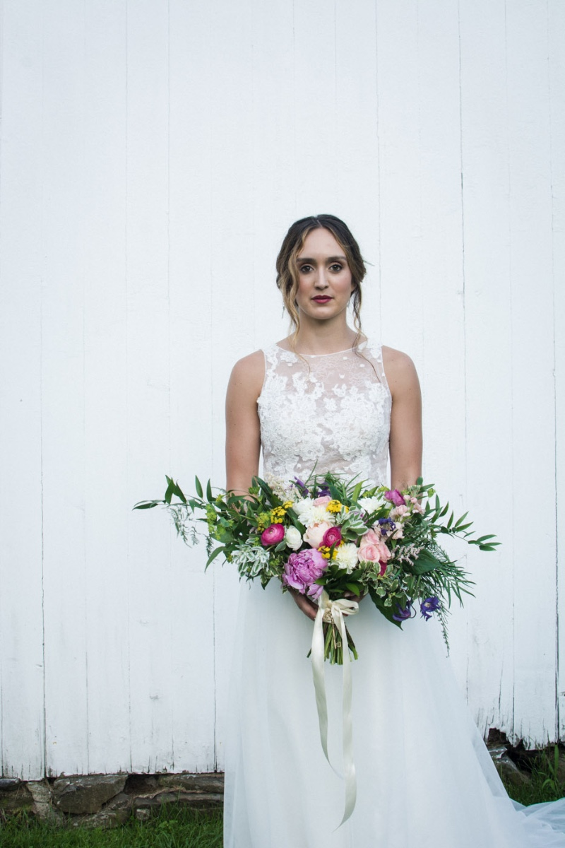 Rustic wedding garden bouquet, shown with lace detail dress. Rustic garden wedding