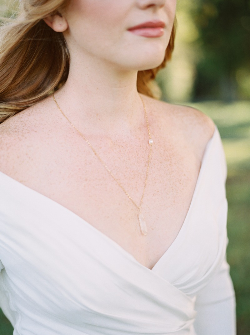 Modern meets vintage: A minimalistic raw crystal pendant from J'Adorn Designs adorns the bride in an old-world inspired styled elopement