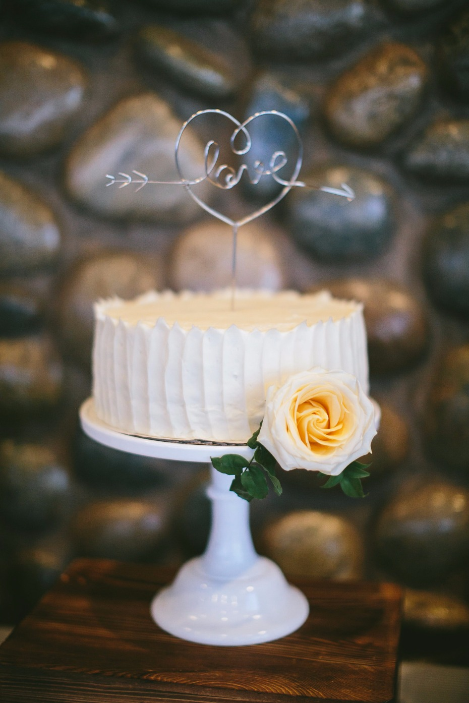 sweet and simple wedding cake with Love topper