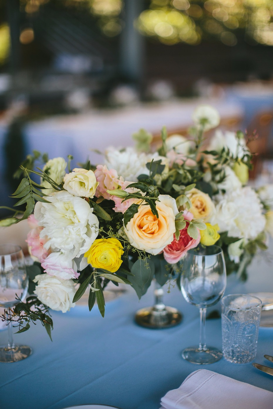 peach pink and yellow wedding centerpiece