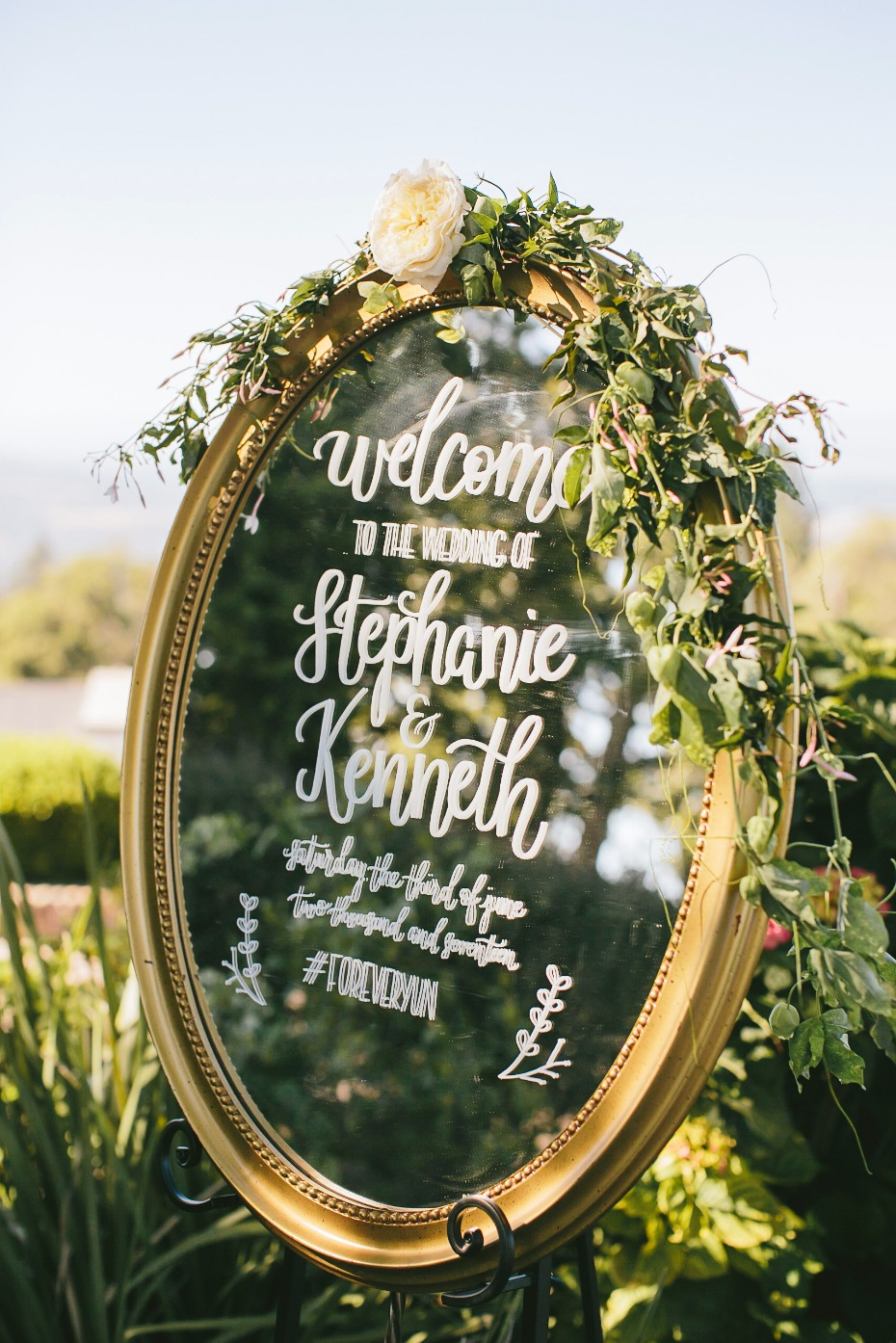 romantic mirror wedding sign with floral accents