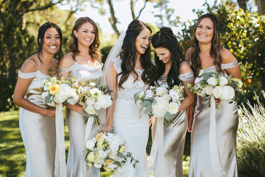 bride and her bridesmaids in silver dresses