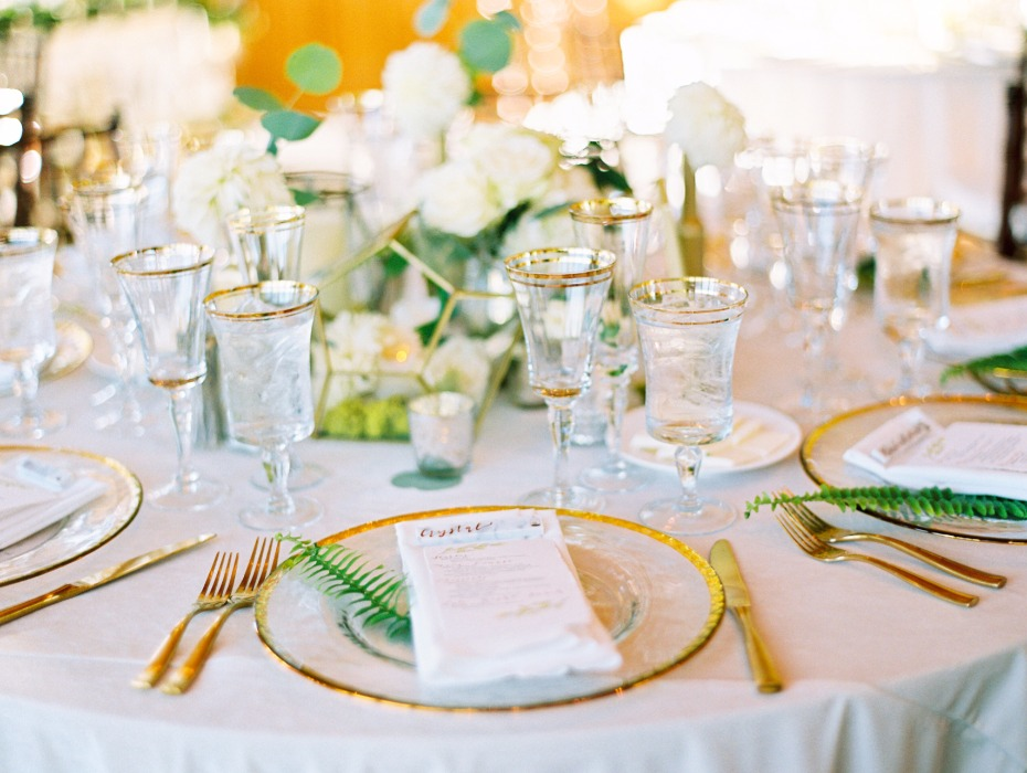Gold and white table with greenery