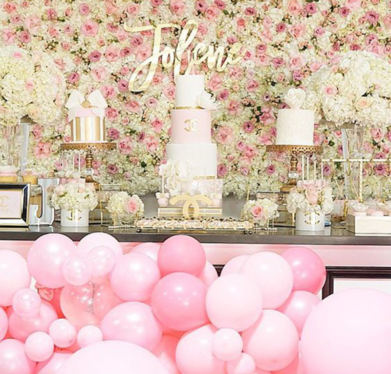 Pretty Pink & Gold Bridal Shower Dessert Table! Gold Chandelier Cake Stands, Pink Balloons & Floral Wall are all the right