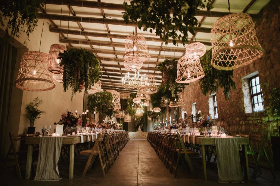 Glam greenery reception with basket lighting