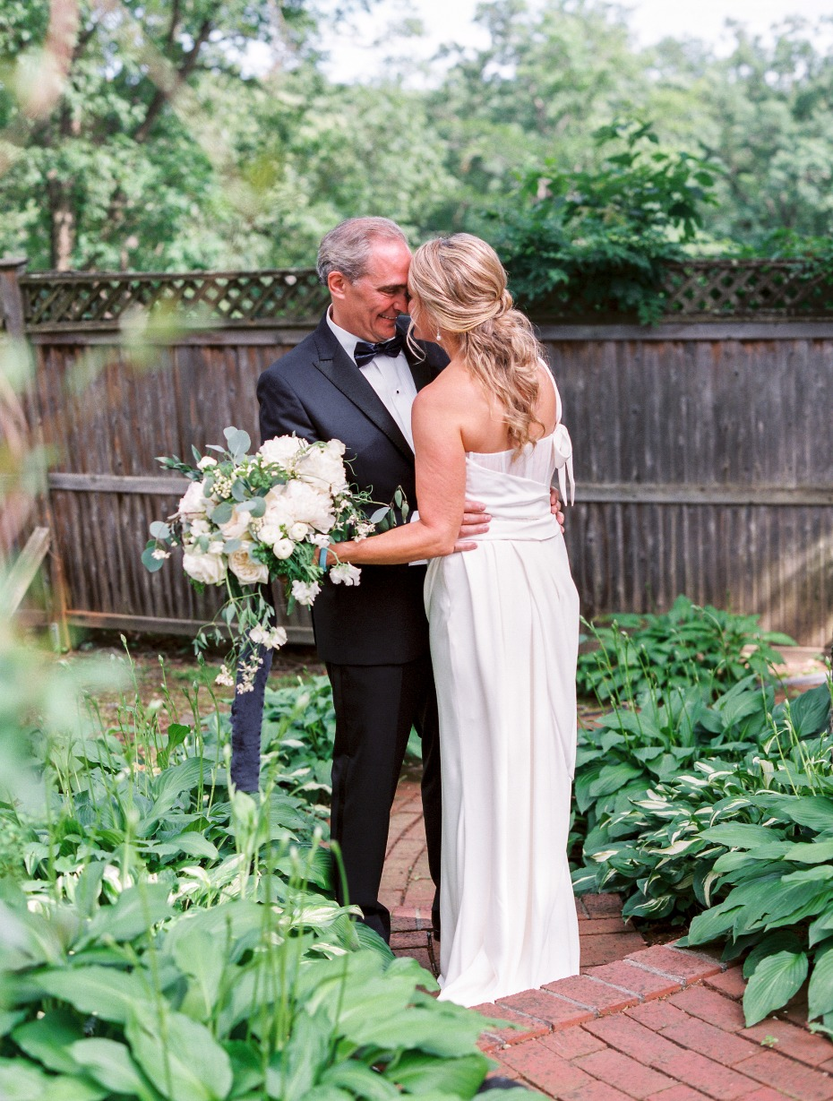 sweet candid moment between bride and groom
