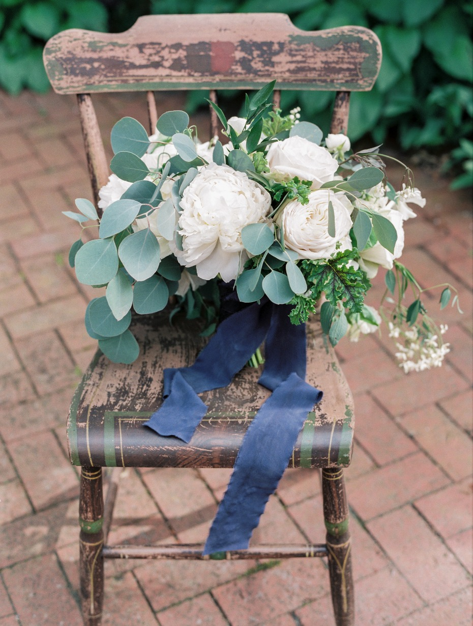 romantic white bouquet with cascading greenery