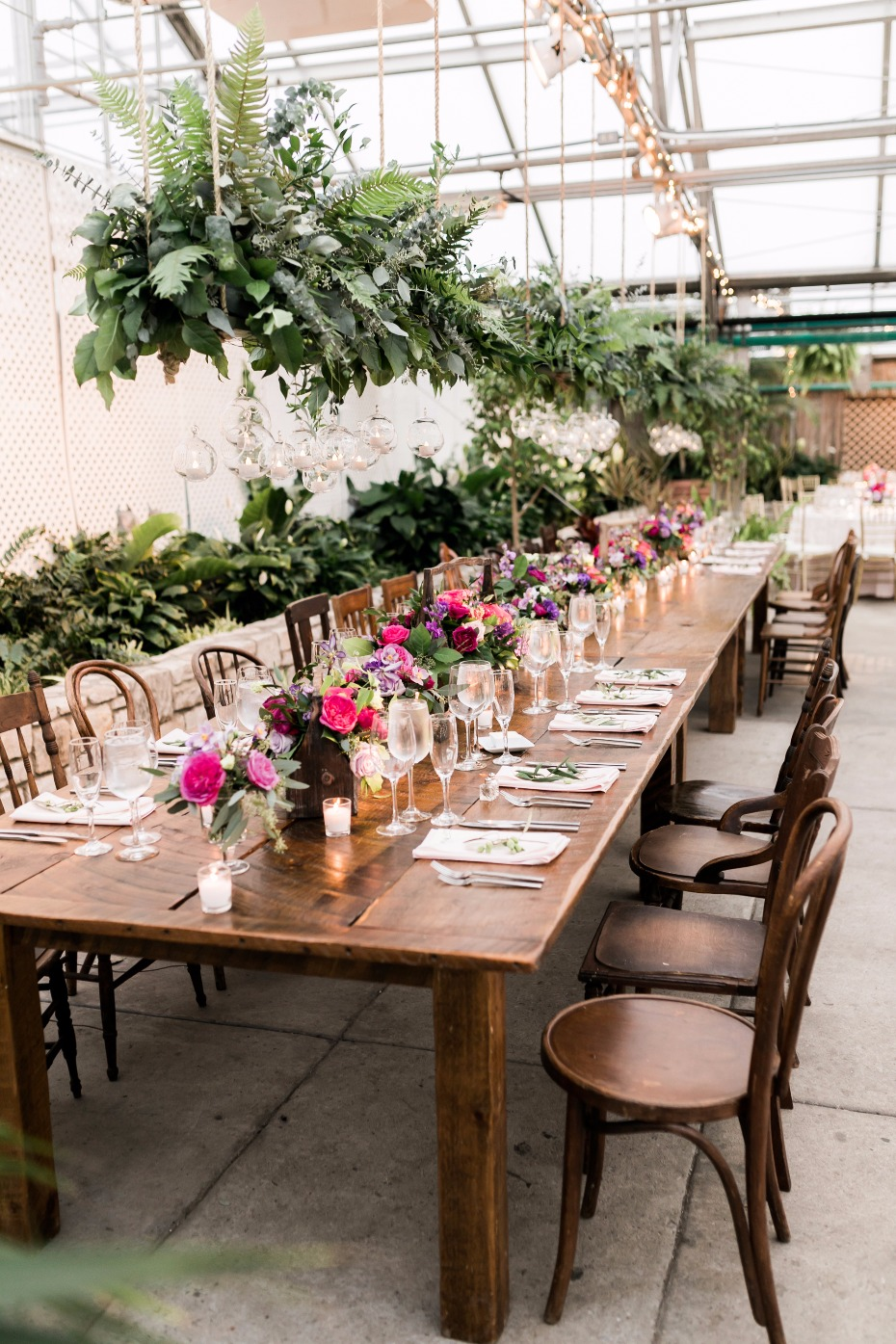 farm table chic family style wedding decor in a giant greenhouse