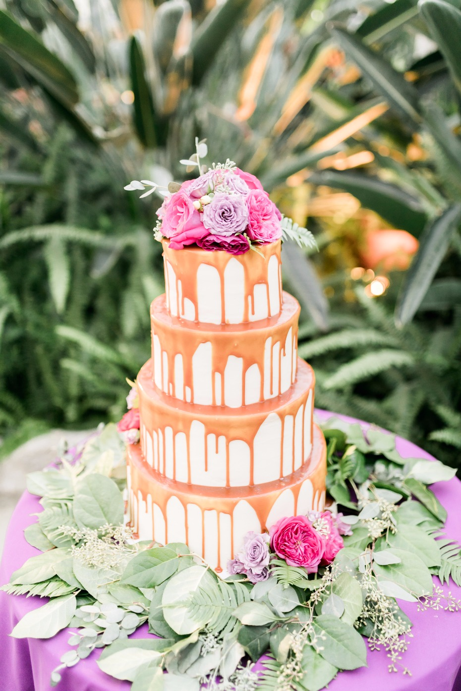 caramel drizzle wedding cake topped with flowers