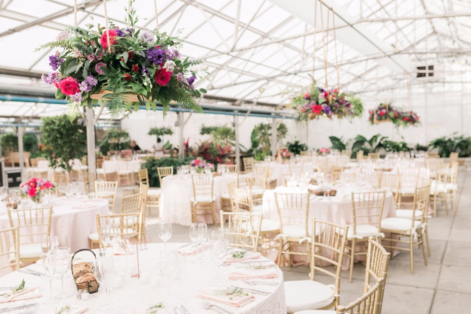gold and white wedding reception in a giant greenhouse