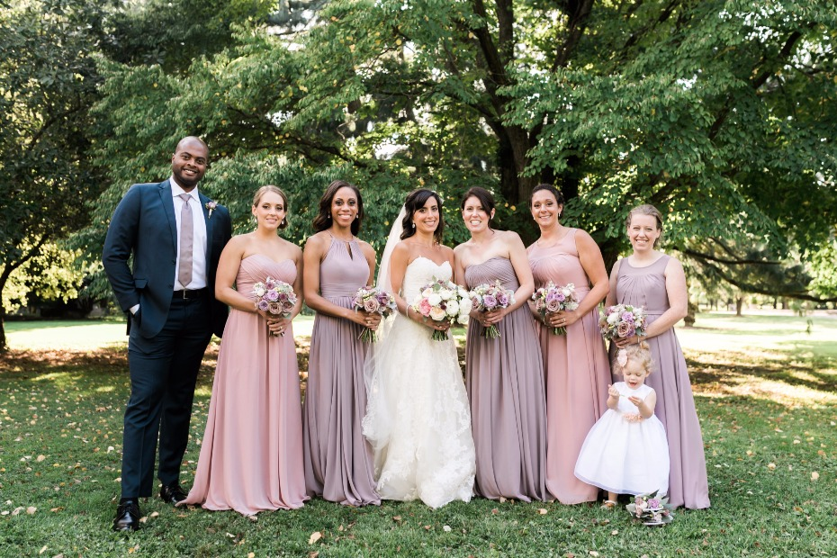 soft pink and purple bridesmaid dresses and bridesman in purple tie