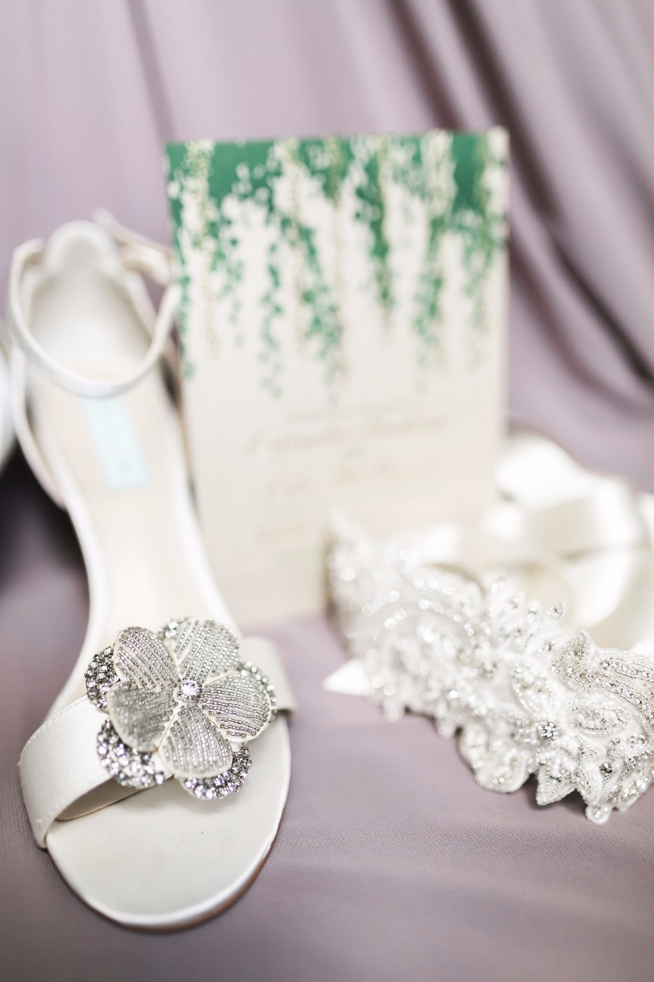 flower accented white wedding shoes