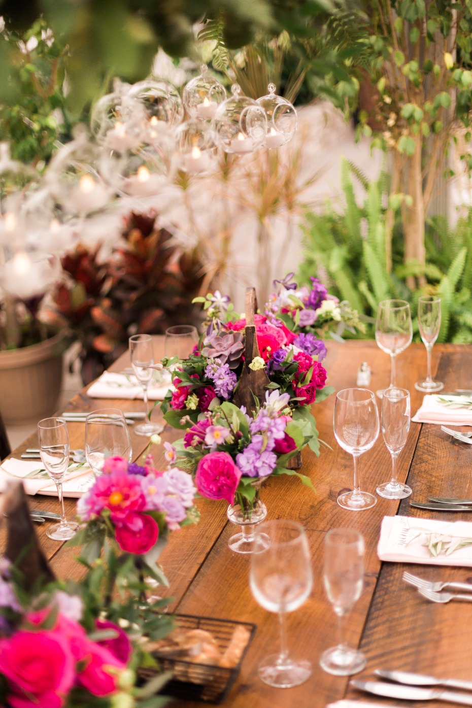 fuchsia and purple wedding floral centerpieces