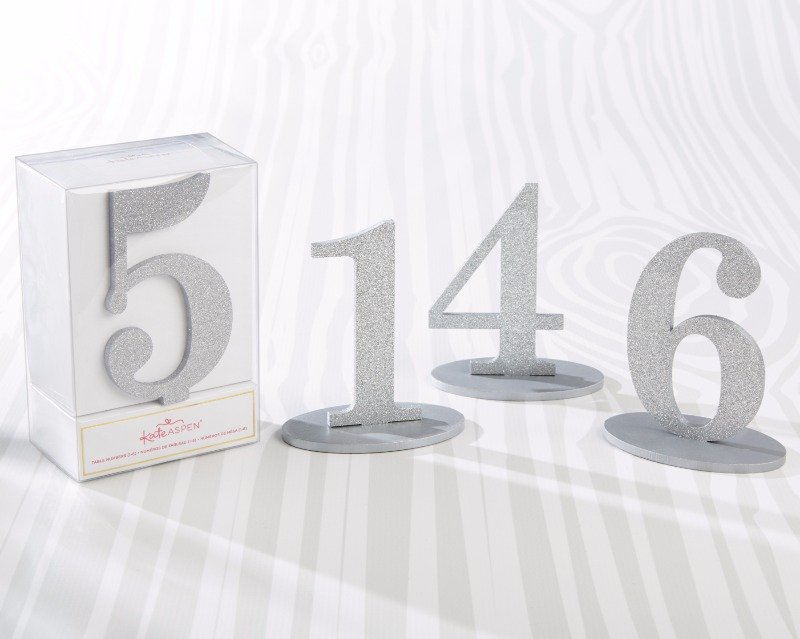 Sparkling like freshly fallen snow, these Silver Glitter Acrylic Table Numbers in 1 through 6 brighten up your winter centerpieces