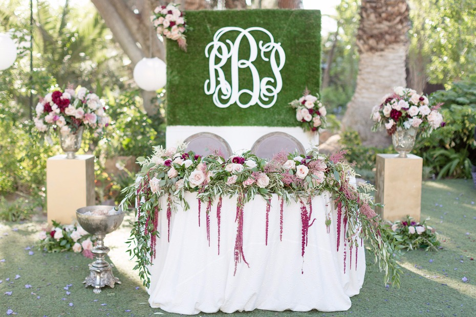 Sweetheart table with monogrammed backdrop