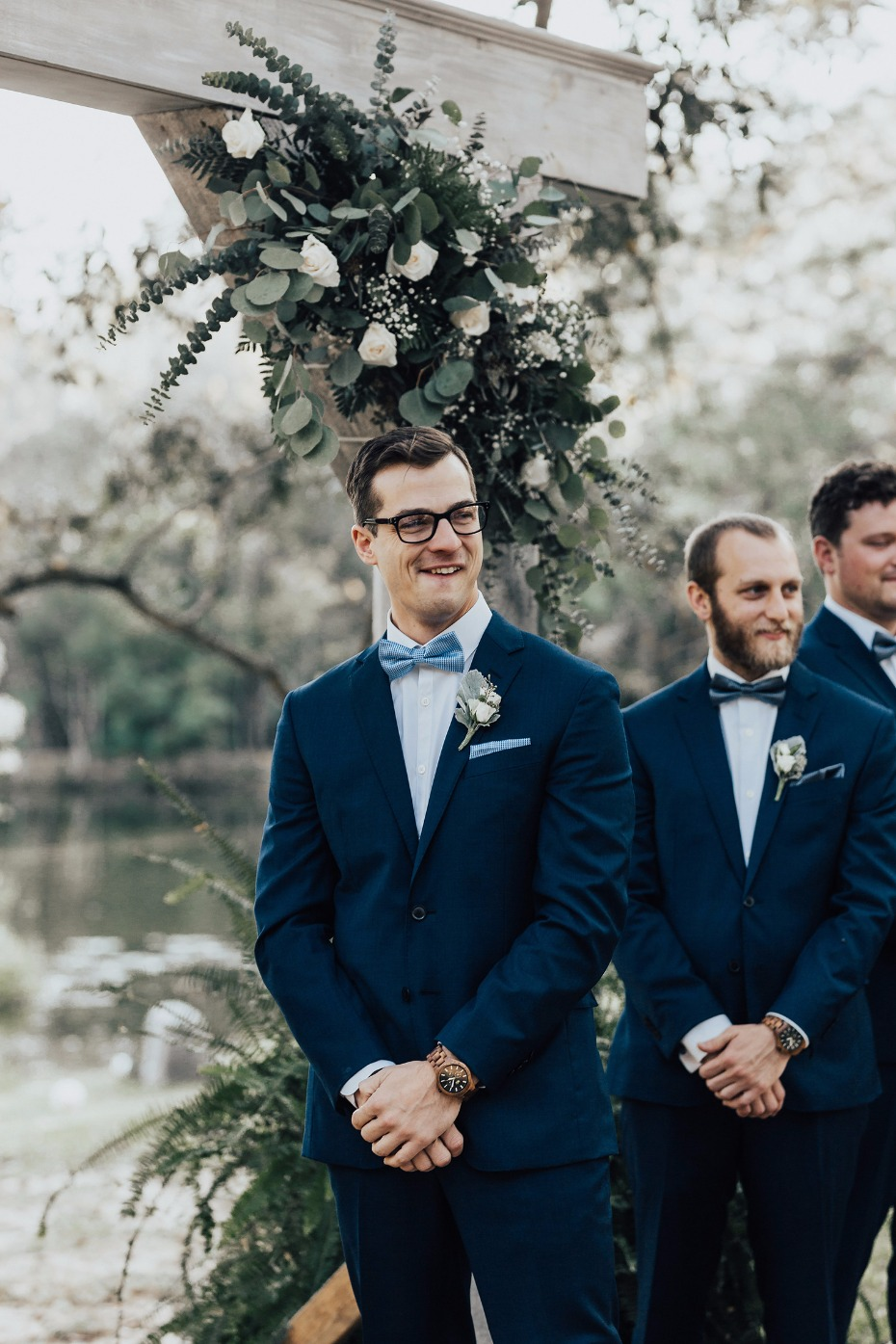 groom trying to hold it together after seeing his bride