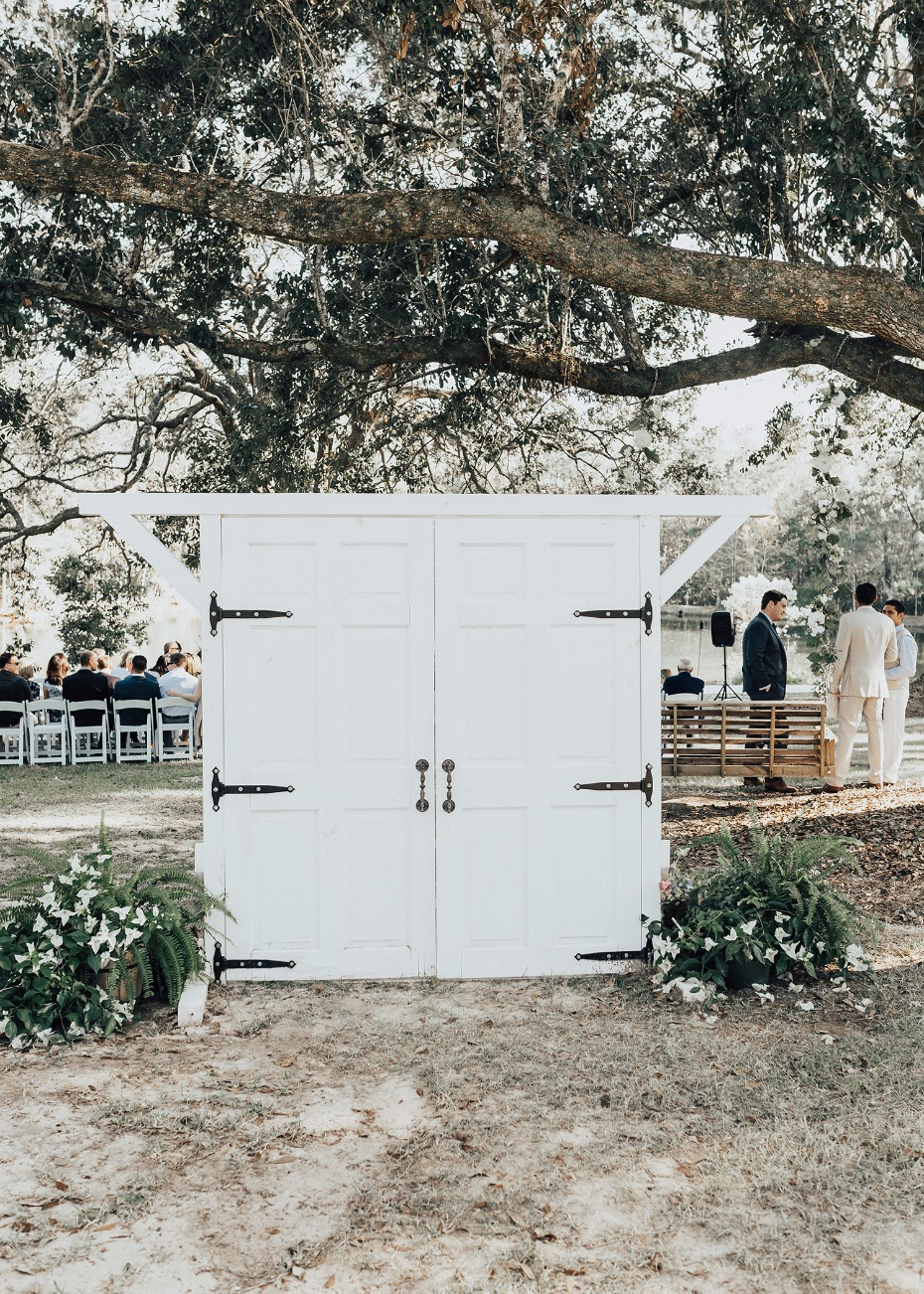 white wedding ceremony entry doors