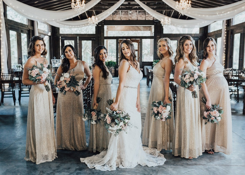 bridesmaids in sparkling champagne dresses