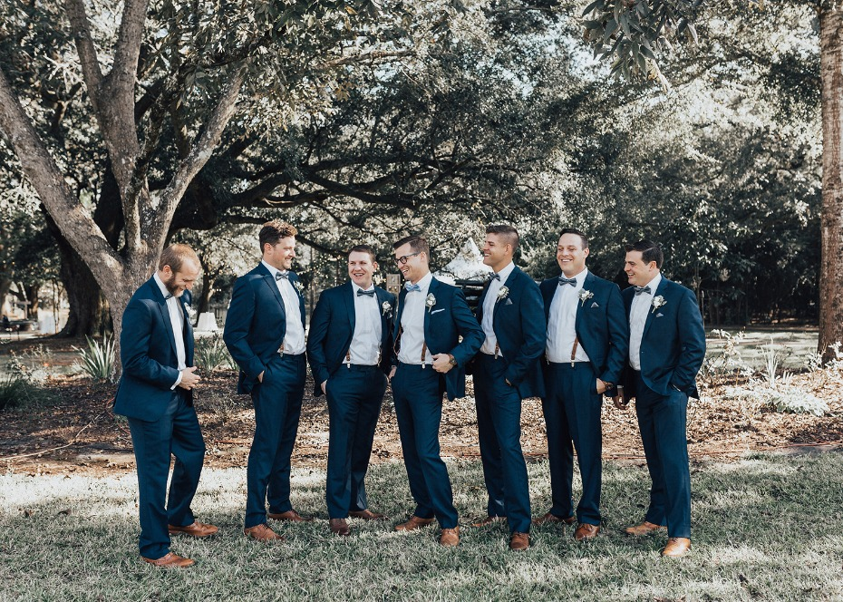 groom and his men in matching navy blue suits