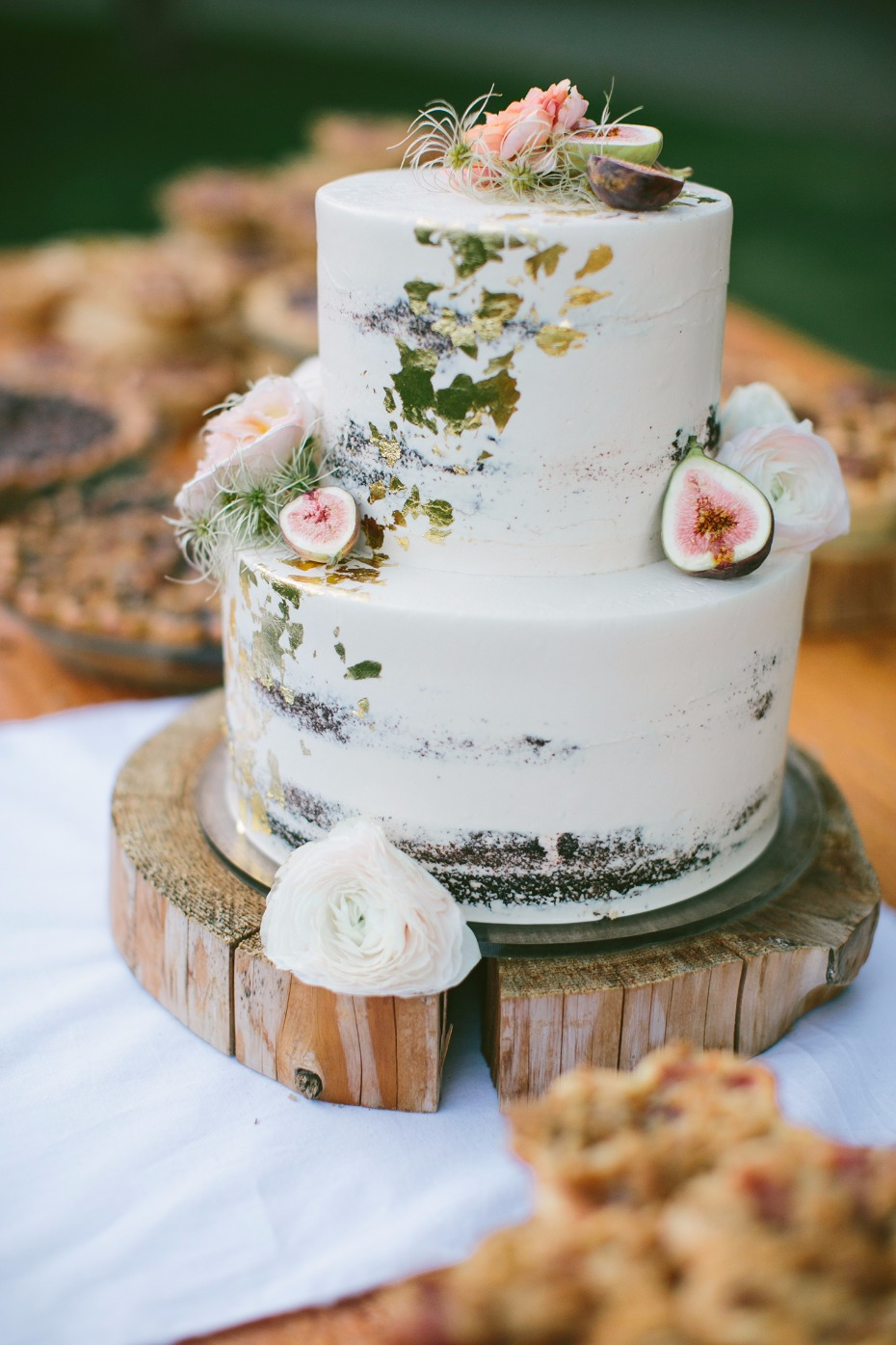 Naked cake with gold foil and figs