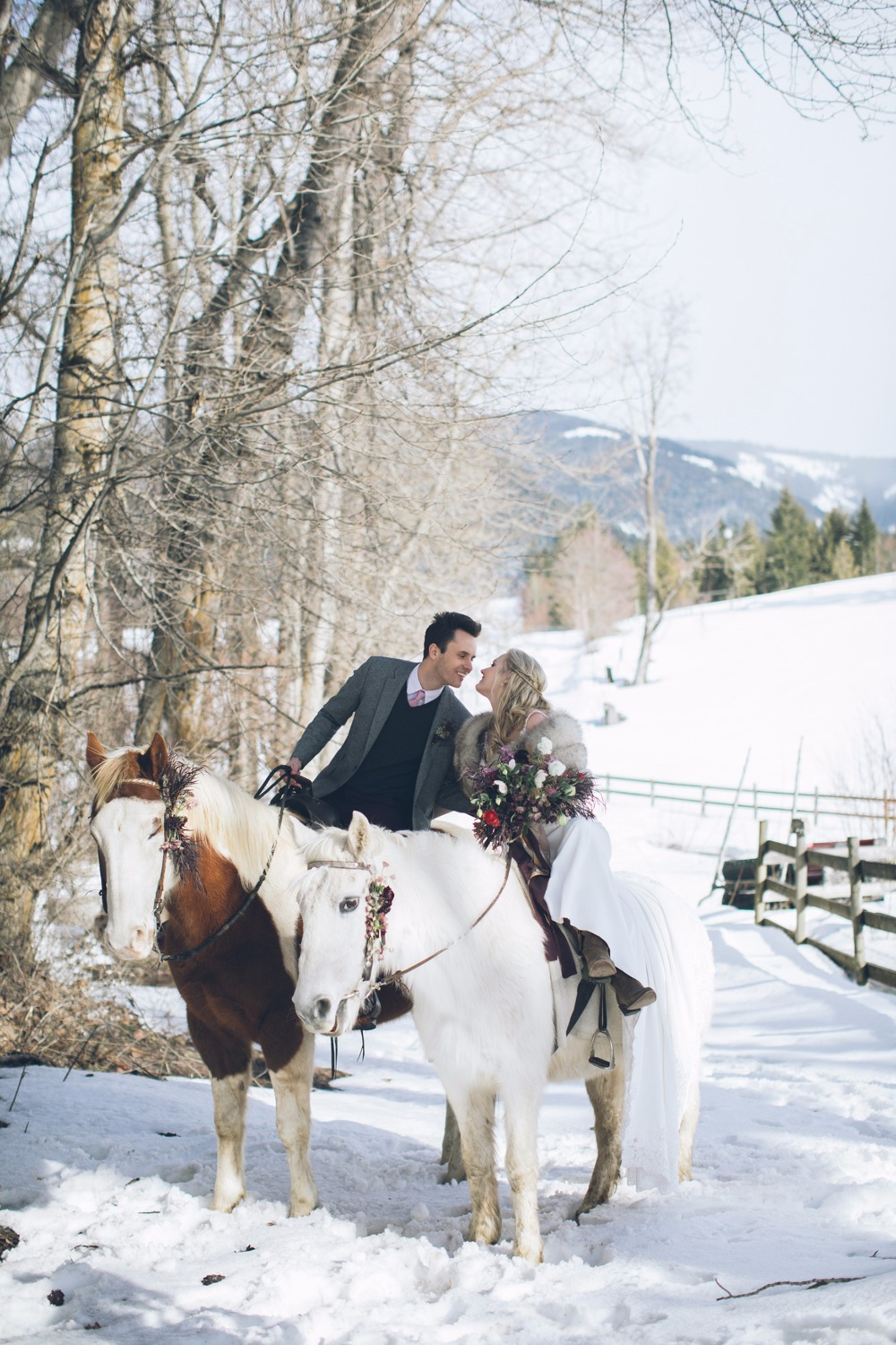 bride and groom on wedding horses