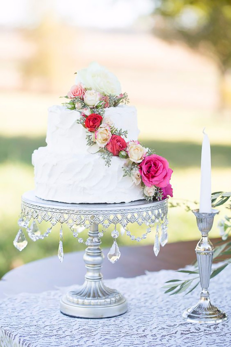 Classic & Elegant White Tiered Wedding Cake on Silver Chandelier Cake Stand created by Opulent Treasures