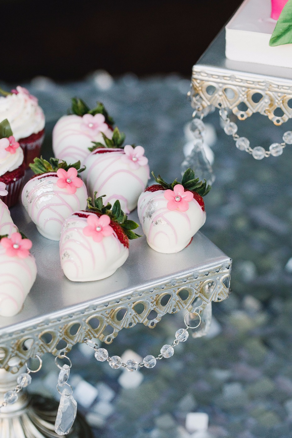 hand dipped strawberries on a vintage esque cake stand from Opulent Treasures