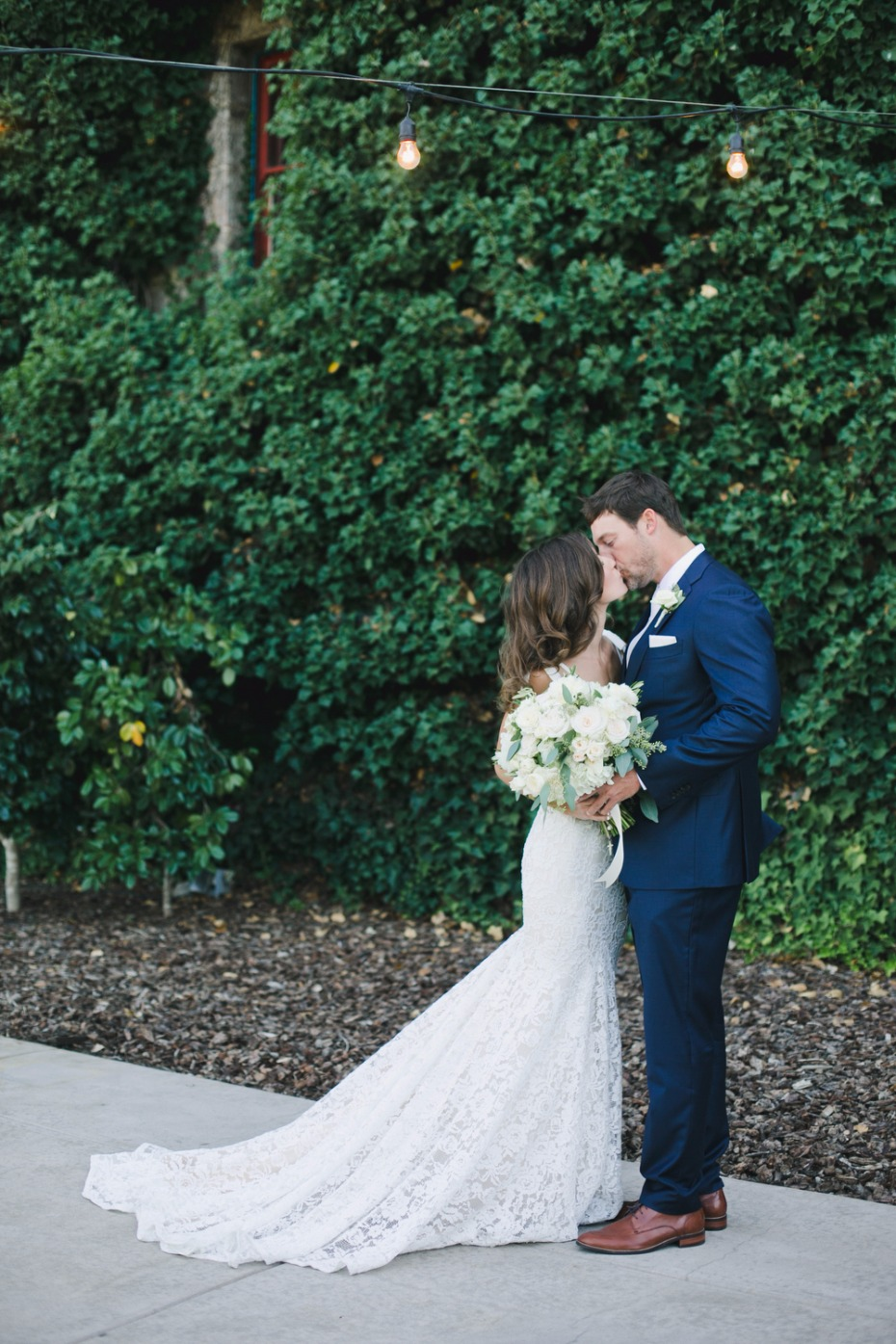wedding couple in glamorous Inbal Dror gown and navy suite