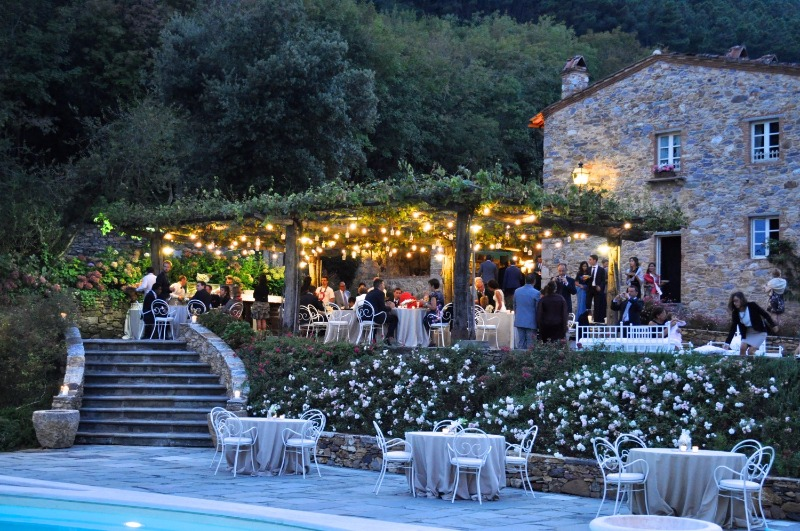 Summer dining in the open air under the suggestive grape arbour at Valle di Badia. The perfect spot to admire the hamlet from on high