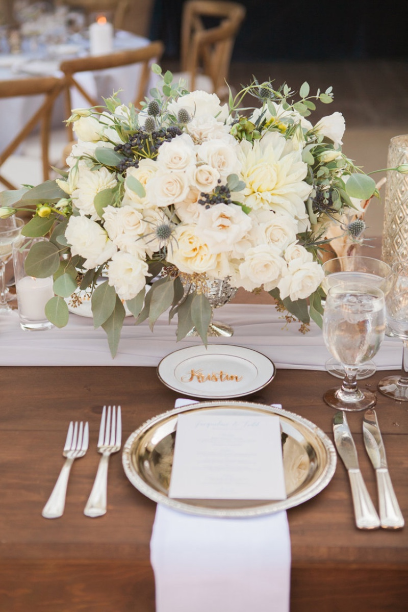 Rustic wood tables and white blooms pop at the Santa Barbara Historical Museum. PC Linda Chaja Planner Magnolia Event Design Floral