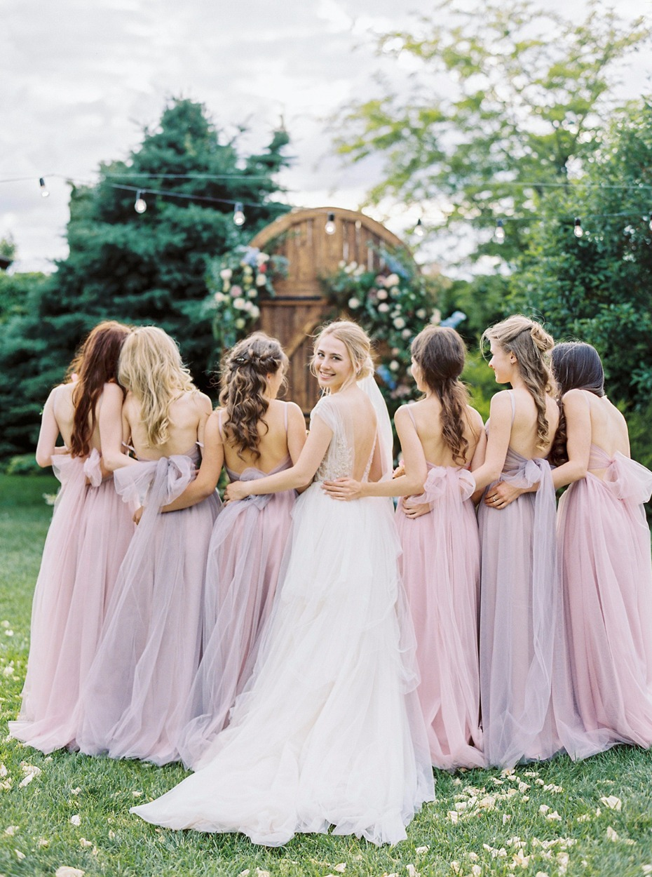 bridesmaids in soft pin and purple.