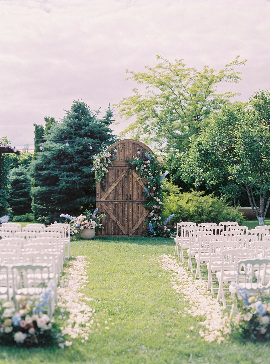 summer time wedding ceremony outside in a beautiful garden