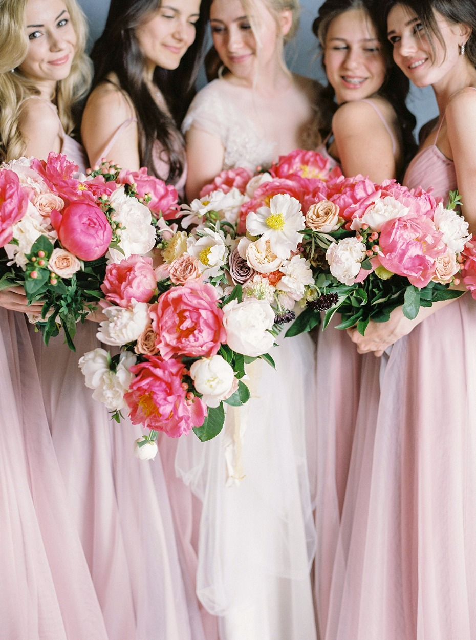 bridesmaids in soft pink dresses