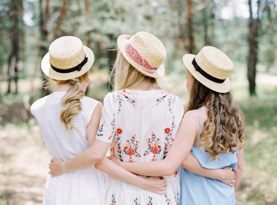 girlfriends in hats a bridal party photo shoot