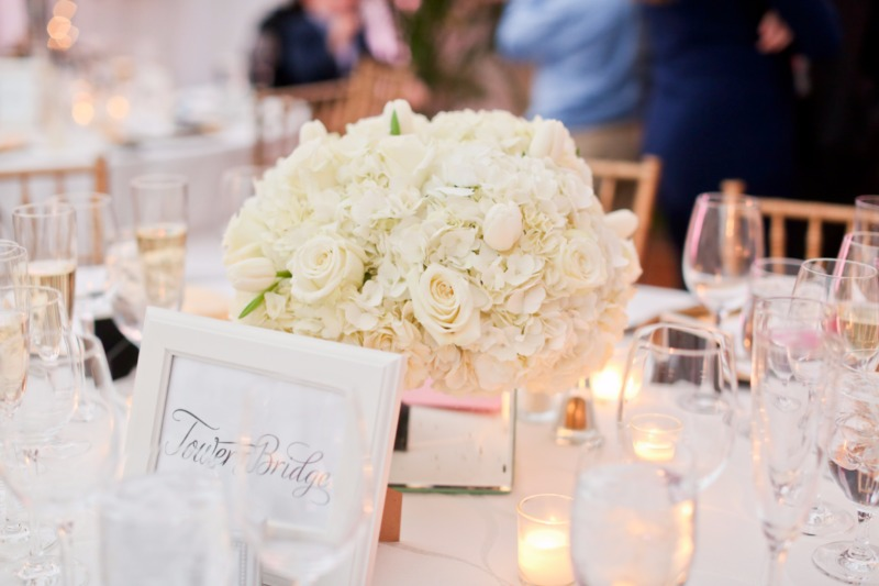 A simple yet stunning white floral centerpiece, was perfect for this winter wedding!
