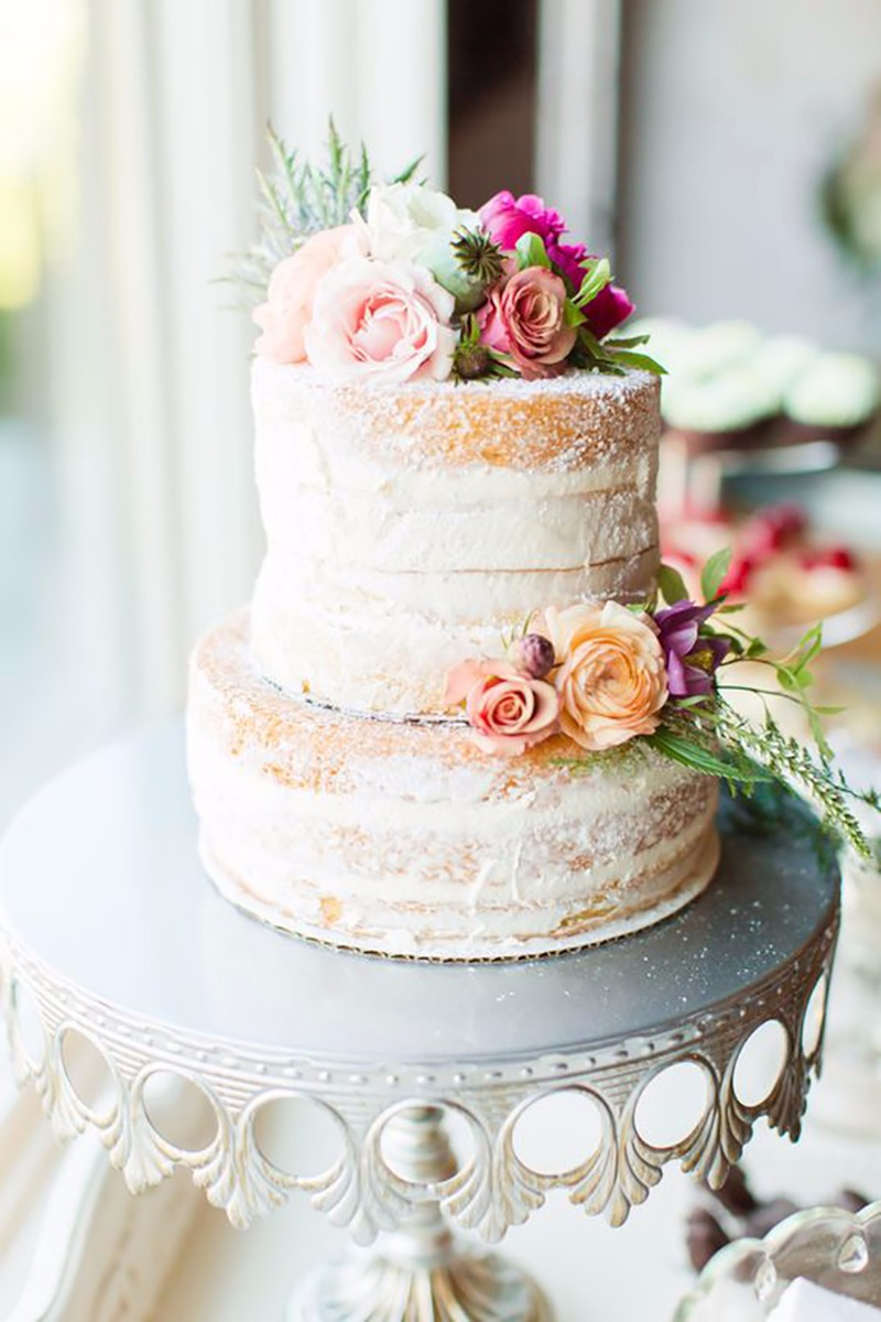 Naked Tiered Wedding Cake with Fresh Florals on Silver Crown Cake Stand created by Opulent Treasures