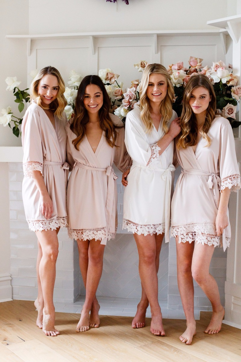 Satin robes with a beautiful floral lace trim. Spoil your Bridesmaids!