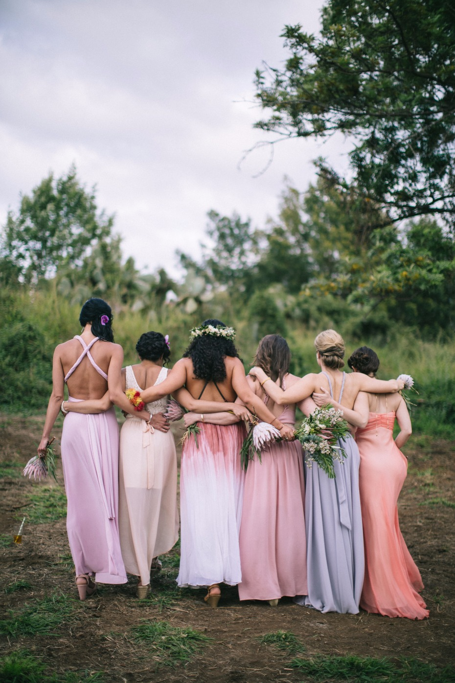 bridal party in mix and matched pastel dresses