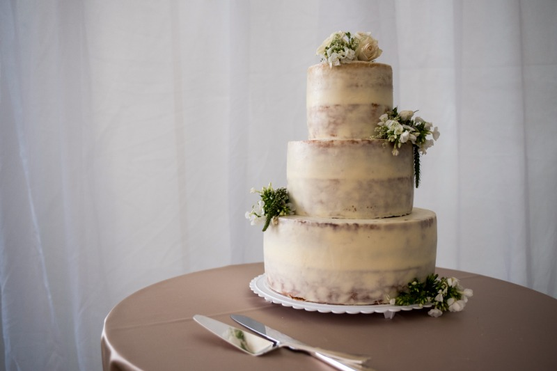 We loved the look of this naked cake at one of our favorite weddings!