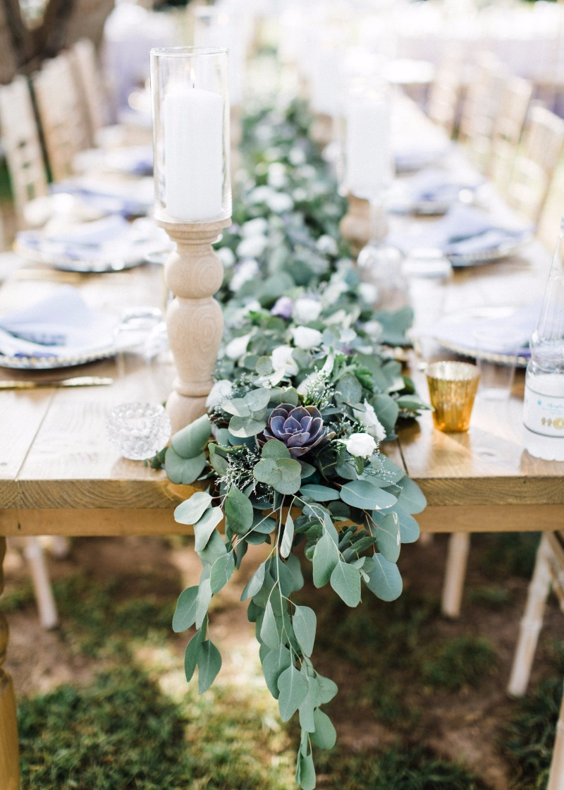 Lush greenery table garlands make the most spectacular centerpieces! For this beauty eucalyptus, succulents, limonium, lisianthus and