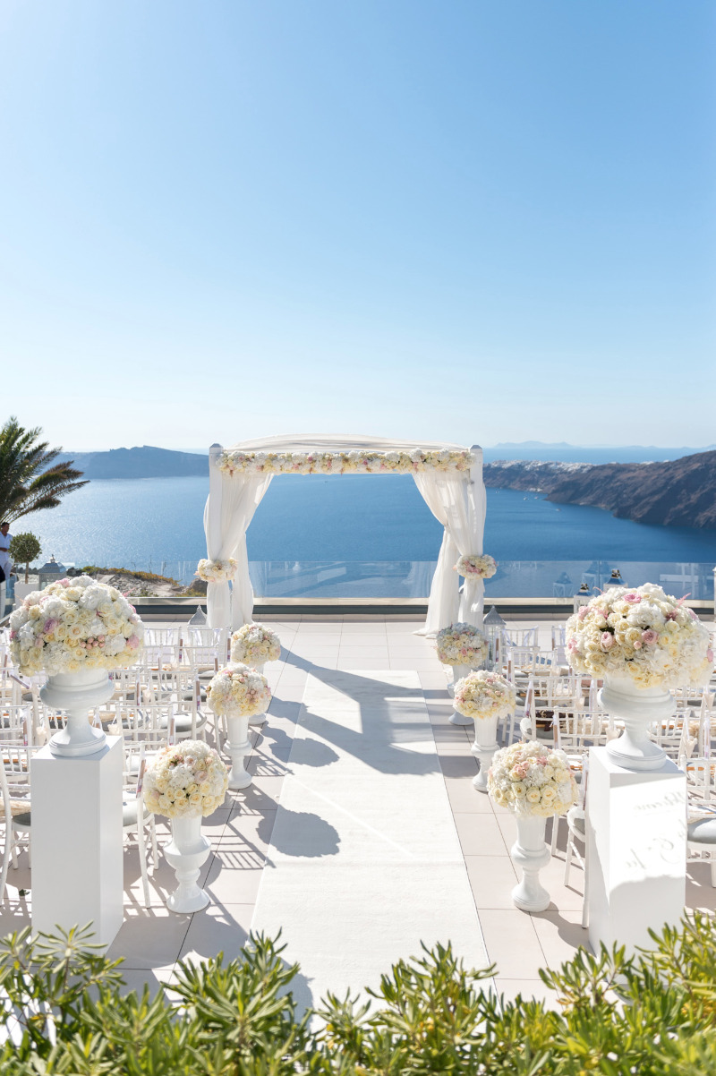 It was the perfect, sunny, early September day to highlight the beauty of this Santorini Wedding.