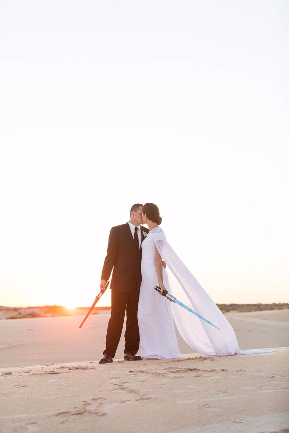 two Jedi share a kiss just as the sun sets on this Star Wars wedding