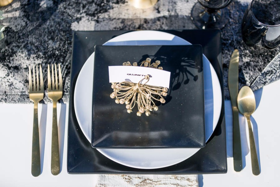 black and gold futuristic wedding table setting